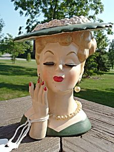 Head vases - I have one that's similar to this that was given to my mom in the 1960s.