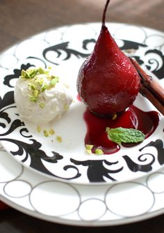 Pears poached in Red Wine and Cinnamon.   Serve with vanilla ice cream topped with crushed pistachio