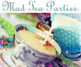 Welcome friends!! Time to plunge into our yearly Mad Tea Party magic. Twinkles dance about as tea pots are filled. Sparkles on top hats, a sign of all that is good. Beckoning you to skip through the garden arbor. Into...