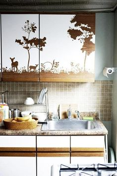 There are tons of adhesive wall decorations out on the market right now — call it contact paper, vinyl decals, shelf paper or removable wallpaper. Any of the above is a great go-to for enhancing your kitchen cabinets on the fly. Easy to remove, and very affordable, these are also a very do-able stopgap measure before your dream kitchen makeover.
