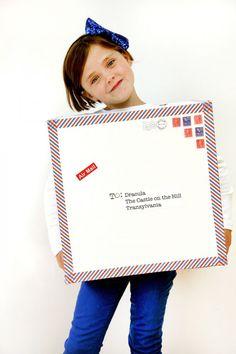 Put those Honest boxes to good use! DIY Air Mail Costume | via Studio DIY #halloween2013