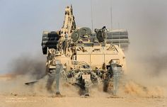 A mighty Trojan Tank belonging to 5 Armoured Engineer Squadron, cuts through the sand on Operation Hamkari in Afghanistan. The AVRE (Armoured Vehicle Royal Engineers) is used in conjuction with other vehicles and the Python weapon system for clearing IEDs (Improvised Explosive Devices).