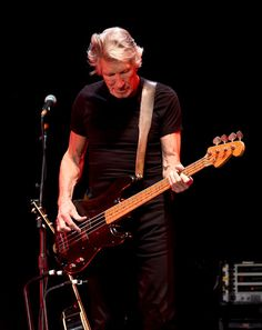 Roger Waters Photos Photos - Musician Roger Waters performs during Desert Trip at the Empire Polo Field on October 16, 2016 in Indio, California. - Desert Trip - Weekend 2 - Day 3