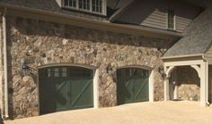 Two 9x7 Model 5334 Carriage style overlay garage doors with Arched Stockton top glass installed by the Richmond store.