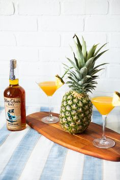 Pineapple, orange juice, mango, oh my! This tropical rum cocktail recipe is delicious for anytime of the year. Shake with ice to combine. Strain into Martini glass and garnish with cherry. #bluechairbay #spicedrum #BCBHappyHour
