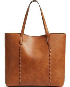 Crisscrossed whipstitching traces the seams of this lightly structured faux leather tote that's big enough to use for commuting or for weekend getaways.