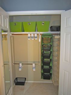 How to inexpensively organize a childrens nursery closet. Love the dollar store baskets in the hanging shelves.