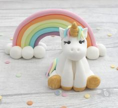 "Handmade rainbow and unicorn sugarpaste cake topper, made to order to decorate your celebration cakes. The rainbow model is approximately 3 tall, and 6"" wide , and the unicorn is approximately 3"" tall but this may differ slightly as all models are hand made. Figures are made from"