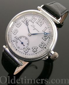 An early large silver round vintage Longines watch, 1924