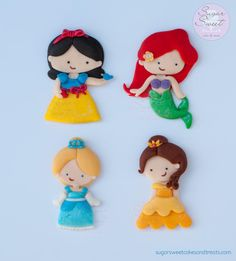 hand cut fondant cake toppers for a princess themed cake. 3 1/2 inches high.
