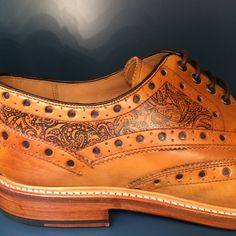 Paisly tattoo design on brogue shoes