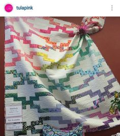 I love this version of my #interlockquilt that is being offered as a kit from @quiltique in Las Vegas made up in @tulapink fabric. Beautiful! Pattern alone is available as a PDF in my shop and on paper in quilt shops. Be sure to ask for it! #jellyrollfriendly