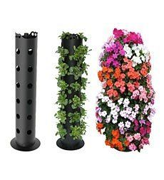 Flower Tower Freestanding Planter by Problem Solvers. $34.95. Flower Tower Freestanding Planter. Add the Flower Tower to a deck, balcony or patio for a splash of color with big impact. This flower planter has a unique internal watering tube with graduated sized holes at various heights. Just water from the top opening and the water reaches evenly throughout the planter. Holds 30 standard nursery sized plants for a stunning display anywhere in the garden: pool, balcony or deck. ...
