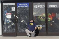 An FBI investigator investigates the scene of a shooting outside a military recruiting center on Friday, July 17, 2015, in Chattanooga, Tenn. Mohammad Youssef Abdulazeez of Hixson, Tenn., attacked two military facilities on Thursday, in a shooting rampage that killed four Marines. (AP Photo/John Bazemore) Photo by Associated Press /Times Free Press.
