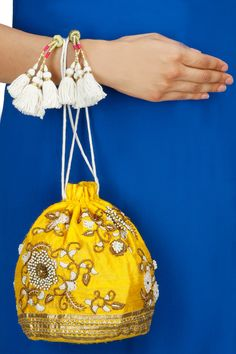Yellow floral embroidery potli available only at Pernia's Pop-Up Shop.