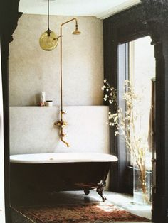 Warm tones cast quite the spell when paired with a dark accent walls, as you can see from the dreamy bathroom featuring black detailing.