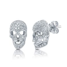 """This cool pair or 3D skull head stud earrings is made of fine sterling silver, stamped with a """"925"""" quality mark and rhodium plated. Set with 140 high quality round cut micro pave set cubic zirconia CZ (1mm). Stones total weight is 0.7 carat. Earrings measure 0.5 inch L x 0.3 inch W and secure with edge posts with butterfly back clasps. Nickel free."""