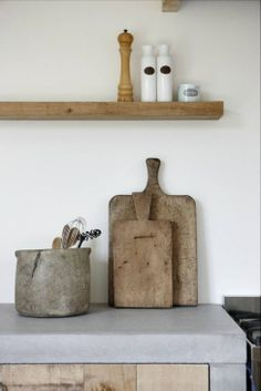 cement and reclaimed wood in kitchen barefootstyling.com