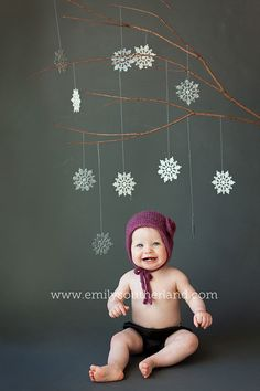 snowflakes on branch with dark backdrop For another baby xmas card photo shoot? Baby U might be perfect age for this!!