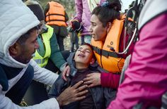 18 NOV: A mother hugs her son after arriving on the Greek island of Lesbos along with other migrants and refugees after crossing the Aegean Sea from Turkey. Thousands of those seeking refuge in Europe come from Syria Iraq and Afghanistan. They face a perilous journey and the island of Lesbos has seen a huge number of arrivals.  PHOTO: BULENT KILIC / AFP  #BBCSnapshot #Lesbos #Greece #refugee #migrant #Syria #Iraq #Afghanistan #mother by bbcnews