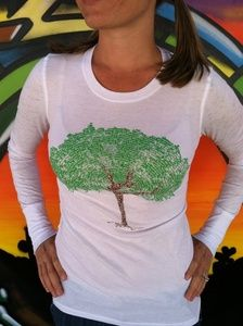 Think Positive Apparel's tree design. The whole tree is made out of little words making up positive affirmations.