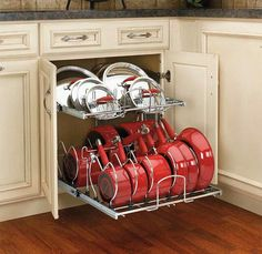 Pots + Pans: Basically what you're doing is turning your not very space-efficient cupboard into a drawer that looks and stores like a dishwasher. Get pumped. Your days of stacking and unstacking and restacking heavy pots and pans are numbered. (via Extra Storage)