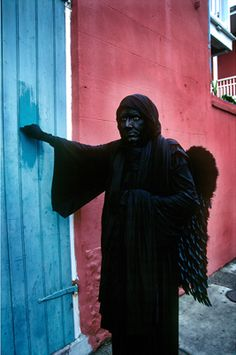 Dark Angel by famed photographer ~ George Long. This would scare the pp out of me. Yikes!!! I would be running through the French Quarter like a wild animal. Everyone would follow me 'cause they would think it was another parade or second-line. I'm sort of scared right now.