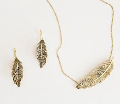 feather choker  matching earrings,armlet, cuff and long necklace available  logo stamped  solid brass. By BISJOUX, Karin Hanssen
