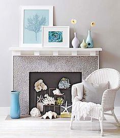 Make your nonworking fireplace a coastal theme focal point with these great ideas! Featured on Completely Coastal. That empty fireplace nook provides a great space for all kinds of displays and decorative storage as well!