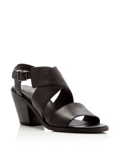 Eileen Fisher's timeless sensibility is front and center in these finely crafted leather crisscross sandals, set on steady stacked heels with adjustable buckle closures. | Leather upper, leather linin