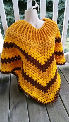 Hot Off My Hook! Project: Cowl-Neck Poncho Started: 30 Sept 2015  Completed: 03 Oct 2015 Model: Madge the Mannequin Crochet Hook(s): 7mm, Cowl portion J, Granny Stitch Yarn: Redheart Super Saver Bernat Super Value Color(s): Gold, Bright Yellow, Walnut Pattern Source: Simply Crochet Magazine Issue No. 25 Pattern Designed By: Simone Francis Notes: This is my 31st Cowl-Neck Poncho!