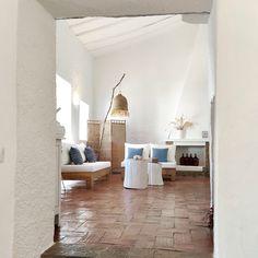 Farmhouse renovation into a rustic minimalist hotel