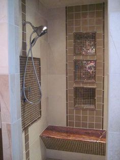 Glass tile mosaic inserts in a travertine shower, elegance with a touch of shimmer!