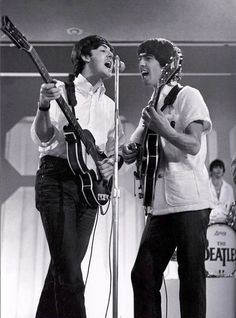 Paul and George...I like this casual stuff. Forearms never looked so good. :D