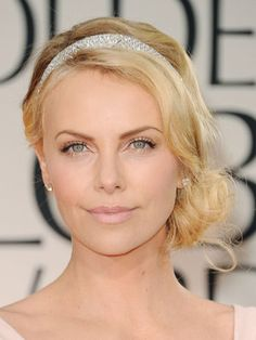 Now having an angled bob, I'm on the lookout for short hair up-do's! My new celebrity hairstyle muse: Charlize Theron.