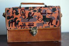 // hieroglyphics embossed briefcase