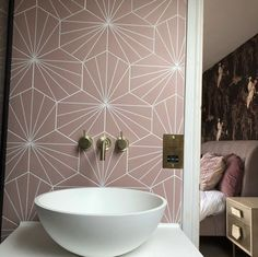 If you want a combination of stunningly simple pattern, a honeycomb tile design, and a richly unique shade then look no further. The Pink Hex Water Lily Pad uses the fan-design of a lily-pad's leaf and introduces it to the geometric design of a hexagonal tile. Not only will the interlocking tiles create their own unique effect, but the soft pink will add the effect of a personalised colour palette. Hexagon Tile Bathroom, Bathroom Taps, Hexagon Tiles, Bathroom Inspo, Bathroom Ideas, Family Bathroom, Bathroom Renos, Honeycomb Tile, Wall Mounted Basins