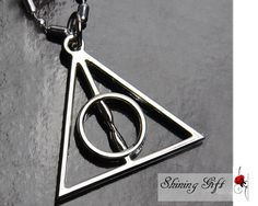 Deathly Hallows Necklace. Inner nerd :)