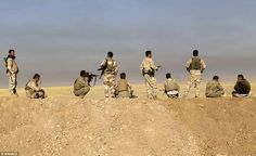 Peshmerga forces stand guard at Kargali village during an operation to liberate Mosul as they advance from the north east of Iraq/Tuesday, Oct 18th 2016