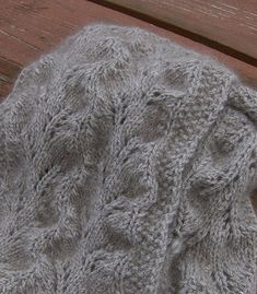 The lace pattern is a fairly easy knit, but makes a lovely design, twining down the length of the scarf in two winding vines. The ends are softly scalloped, adding another mark of uniqueness to this scarf.