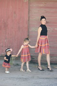 """This is Cristen - """"A California mommy to a spunky little four-year old girl, Charlotte (aka Charlee), a sassy one-year old little girl, Kendall, and wife to her hard working {fitness-loving} husband."""" She is the the owner/editor of TheNapTimeReviewer.com & TheBucketListMom.com. Cristen and her adorable two daughters dressed up in our """"Graphic Red Stripe"""" matching outfits for their mommy and me photo shoot. Super cute!"""