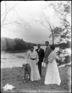Two men and two women with dog by river | Historic New England