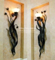 Wrought Iron Art, LTD is Metal artist, handmade, artistic, ornamental, architectural, hot forging, iron sculpture, iron designs.