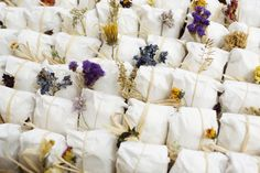 #wedding #favors tied up with string and topped with dried flowers | Photography by joshuabehan.com, Event Design by http://www.trueevent.com, Florals by http://hanafloraldesign.com   Read more - http://www.stylemepretty.com/2011/09/30/classic-philadelphia-wedding-from-susan-stripling-photography/