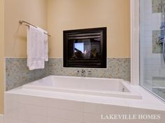 Master Bath:  Glass tile backsplash surrounds the clean lines of the extra-deep tub.