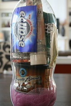"cute idea for gift ""wrapping"". Cut bottle in  two, insert objects of choice, tape bottle back together, then decorate.Clever idea! (This site has several  good ideas)."