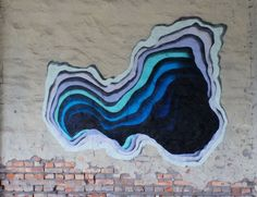 Since 2009, German street artist 1010 has been creating these mysterious, portal-like street art illusions on walls around the world. While at first glance it looks like he's layering colored paper,...