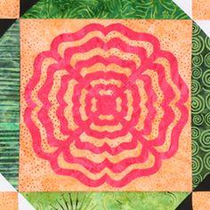 Zippity Zinnia, block #232, by June Dudley.