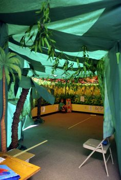 Jungle Jaunt. Jungle tent. A little green paper, fishing string, and a pop up tent make up this room.