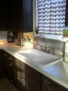 Tin Backsplash.... ahhh why did I have to see this now i do not know what I like better tile or this